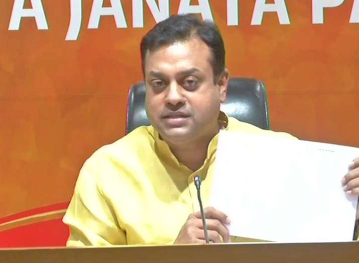 BJP national spokesperson Sambit Patra showing a telegram