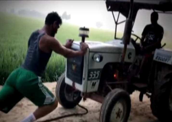 India Tv - Satnam Singh trains with tractor in farm