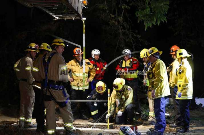 Firefighters search for a 13-year-old boy in a hole near