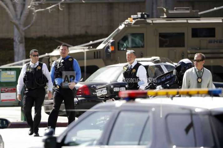 Armed law enforcement personnel exit YouTube headquarters,