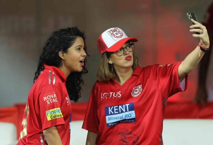 India Tv - R Ashwin's wifePrithi Narayanan and Hazel Keech takes selfie during the IPL match