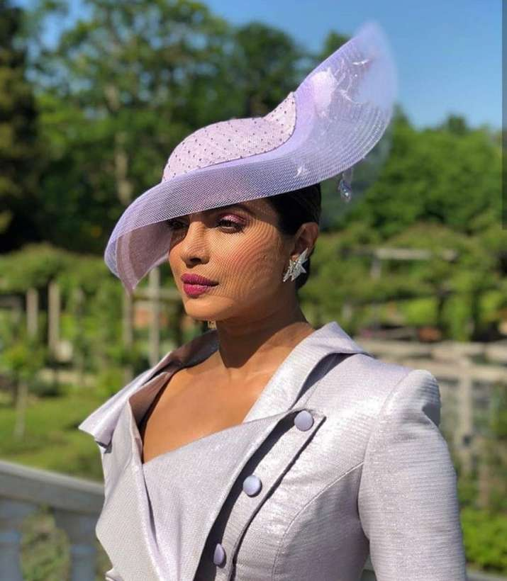 India Tv - Priyanka Chopra at the Royal wedding of Prince Harry and Meghan Markle
