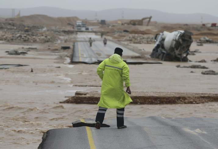 India Tv - An Omani civil defence staff visits a road which has been cut by the flood water after Cyclone Merkunu in Salalah on Saturday.