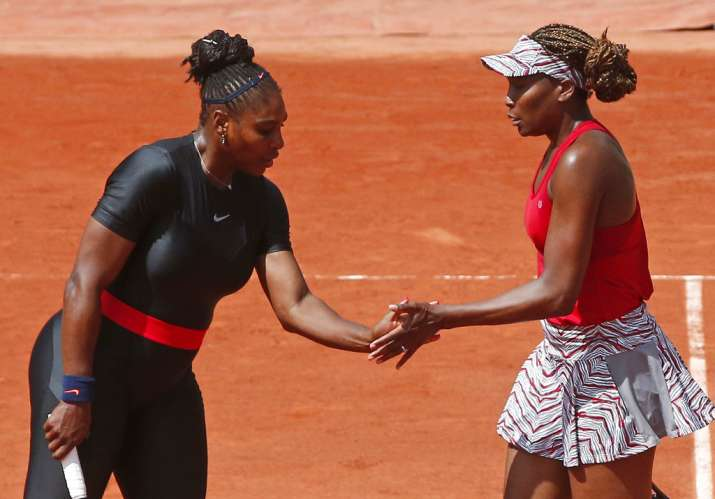 India Tv - Serena and Venus Williams during the women's doubles at the French Open