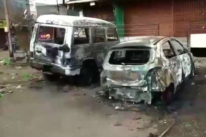 India Tv - Scores of vehicles were damaged and torched along with at least 40 shops in Shahgunj and Chelipura area.