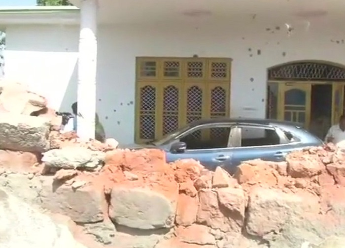 Houses and cars damaged after heavy shelling from Pakistan