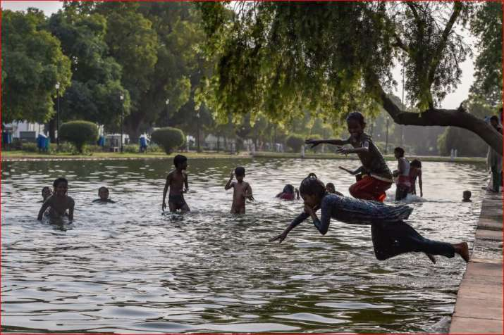 Children beat the heat in the waters at the India Gate Boat