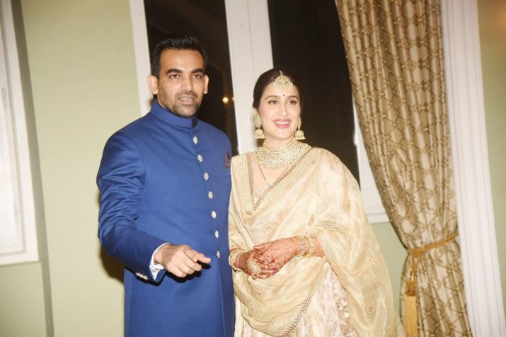 India Tv - Sagarika Ghatge and Zaheer Khan at their wedding reception