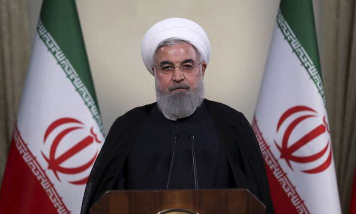 "India Tv - In this photo released by official website of the office of the Iranian Presidency, President Hassan Rouhani addresses the nation in a televised speech in Tehran, Iran, Tuesday, May 8, 2018. Iranian President Hassan Rouhani said Tuesday he'd send his foreign minister to negotiate with countries remaining in the nuclear deal after Donald Trump's decision to pull America from the deal, warning he otherwise would restart enriching uranium ""in the next weeks."""