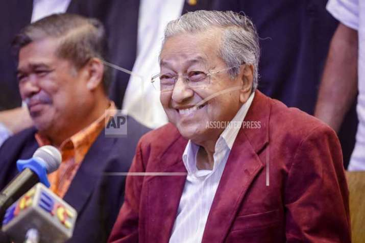 Mahathir Mohamad, center, celebrates at a hotel in Kuala