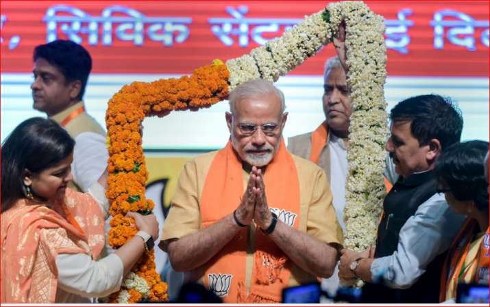 PM Modi being garlanded at the concluding session of the