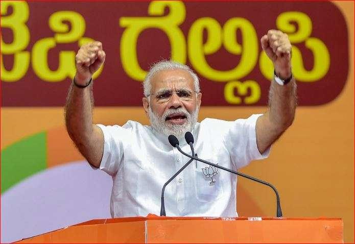 PM Modi addressing a rally in Karnataka