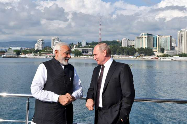 India Tv - PM Narendra Modi and Russian President Putin had plenty to discuss as they sail together from Bocharev Creek to Olympic Park in Sochi. (Photo/Twitter/@MEAIndia)