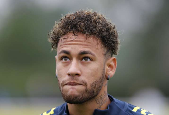 Neymar looks up during a soccer team training session in London
