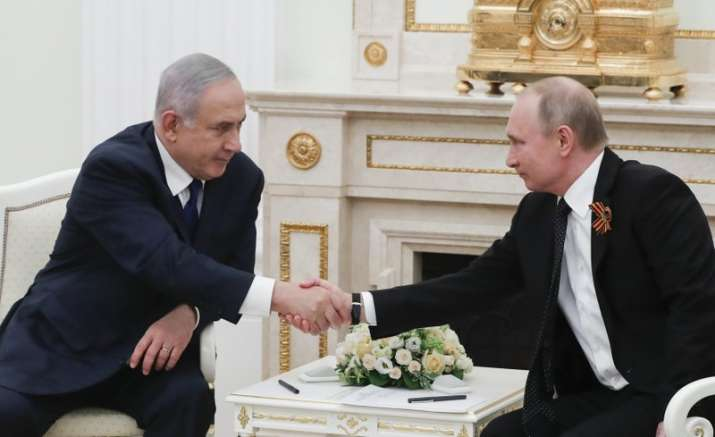 India Tv - Russian President Vladimir Putin, right, shakes hands with Israeli Prime Minister Benjamin Netanyahu during their meeting in the Kremlin in Moscow, Russia, Wednesday, May 9, 2018.