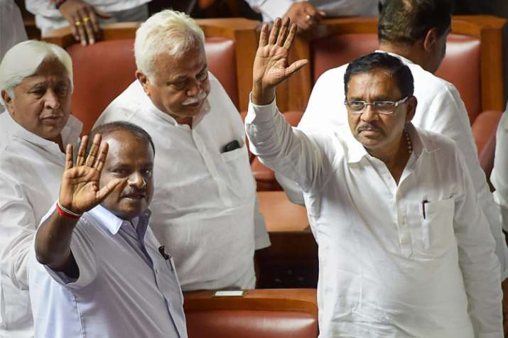 H D Kumaraswamy with his deputy G Parameshwara and other