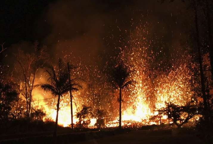 India Tv - A new fissure erupts in Leilani Estates in Pahoa, Hawaii. Hawaii's erupting Kilauea volcano has destroyed homes and forced the evacuations of more than a thousand people.