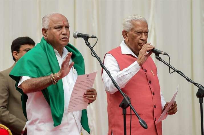 Karnataka Governor Vajubhai Vala administers oath to BJP