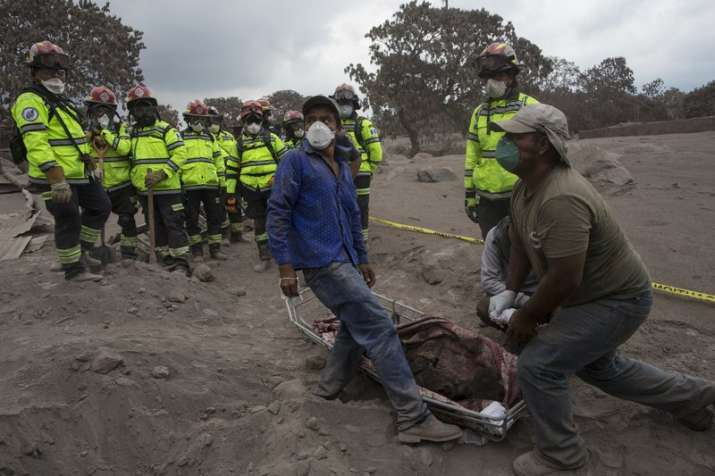 "India Tv - People try to identify the body of a relative who died in the disaster zone near the Volcan de Fuego, or ""Volcano of Fire,"" in the El Rodeo hamlet of Escuintla."