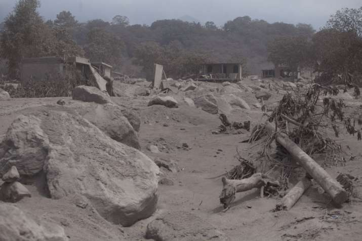India Tv - The village of San Miguel Los Lotes lies destroyed and covered in volcanic ash spewed by the Volcan de Fuego, or Volcano of Fire in Escuintla, Guatemala.