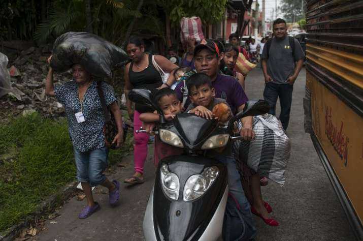 India Tv - Residents evacuates after a new flow of searing hot volcanic material moved down the slopes of the Volcano of Fire in Escuintla.