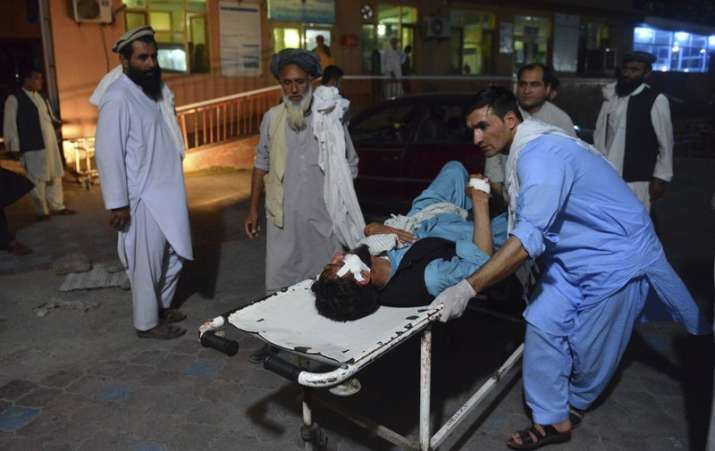 A wounded man is brought by stretcher into a hospital in
