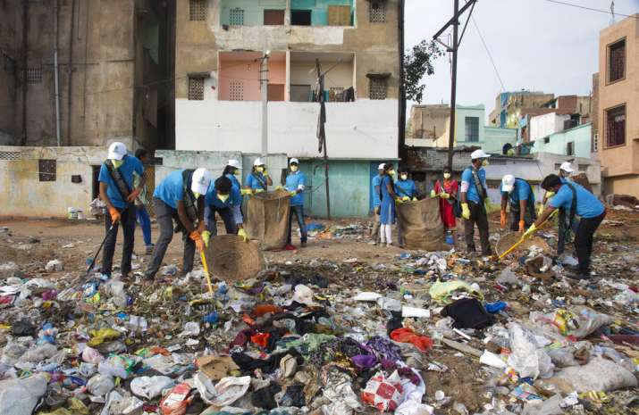 India Tv - Members of National Green Corps clean up plastic garbage along the Musi river in Hyderabad. India is the global host for the forthcoming environmental day celebrations on June 5, 2018 with a theme