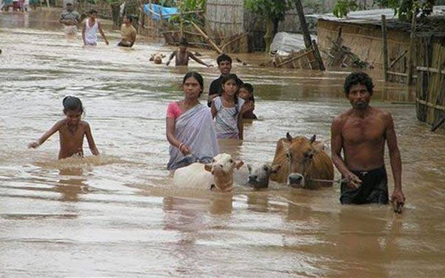 India Tv - The floods have killed at least 30 people have and affected more than 68,000 people in seven districts of Assam.