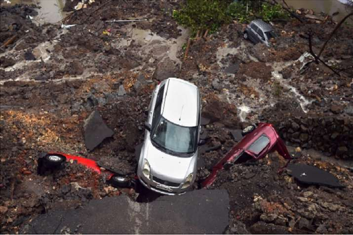 India Tv - Several cars struck in debris after a wall collapsed at a construction site in Antop Hill, Wadala East area, in Mumbai on Monday.