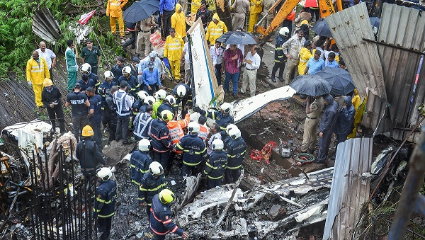 India Tv - The aircraft missed a housing society by a few metres and crashed into an underconstruction site.