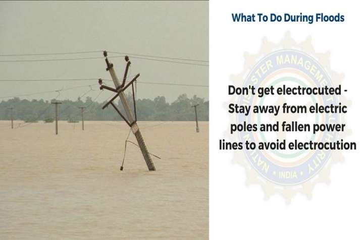 India Tv - Keep distance from electric poles and uprooted power lines to avoid electrocution