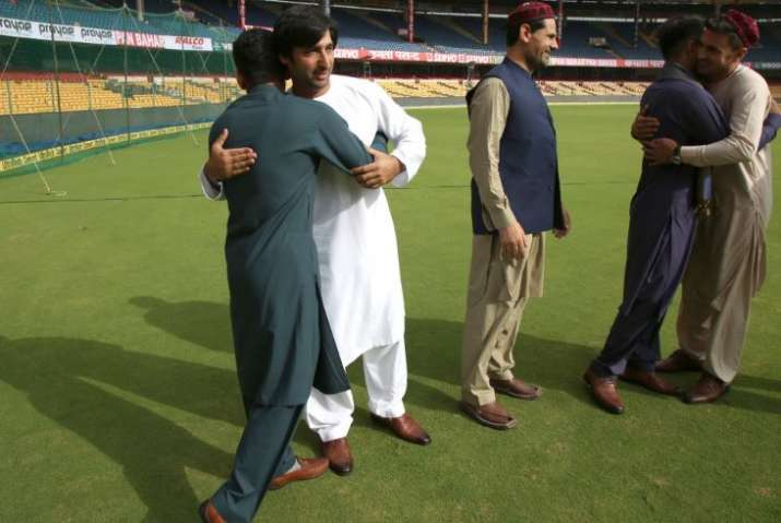 India Tv - Afghan players wished each other on the M Chinnaswamy Stadium