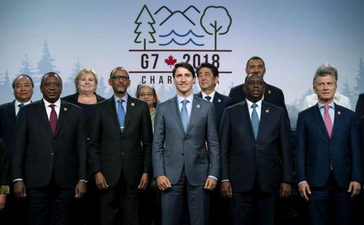 India Tv - Canada's Prime Minister Justin Trudeau, center, poses for a family photo with representatives from G7 leaders, outreach countries and international organizations at the G7 summit
