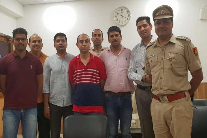 Army Major, Nikhil Handa (C) (in red t-shirt), arrested, in