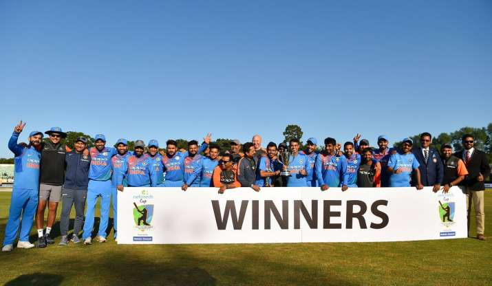 Indian cricket team poses with the trophy