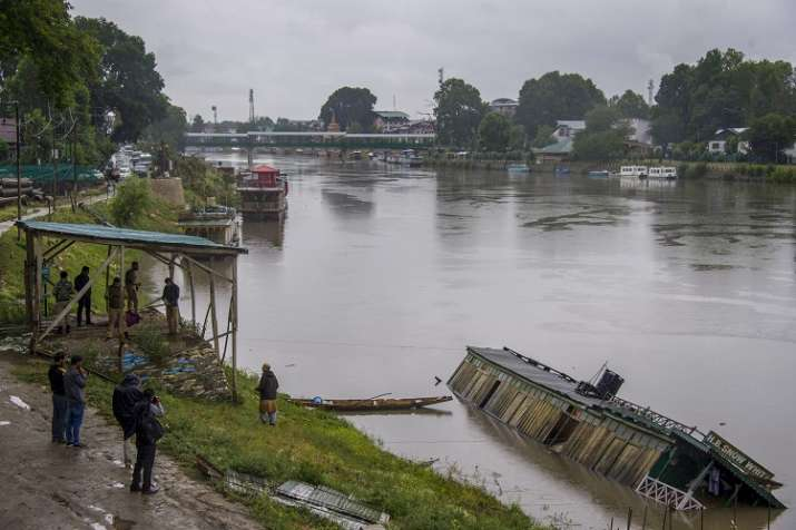 A houseboat capsized during heavy rains at Jehlum, in