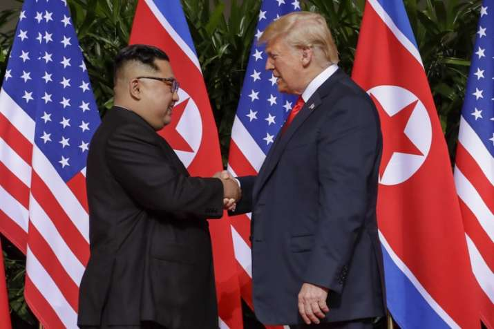 India Tv - US President Donald Trump shakes hands with North Korea leader Kim Jong Un at the Capella resort on Sentosa Island on Tuesday