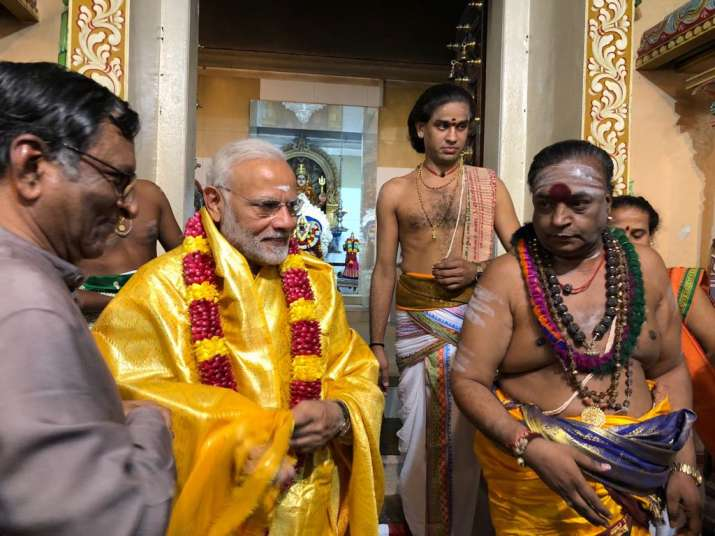 PM Narendra Modi today visited Hindu and Buddhist temples