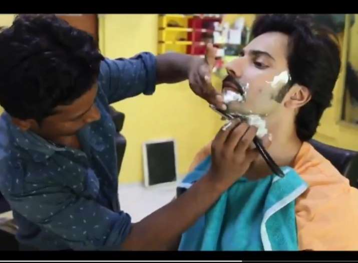 India Tv - Varun Dhawan visits a local barbershop to get the Sui Dhaga look
