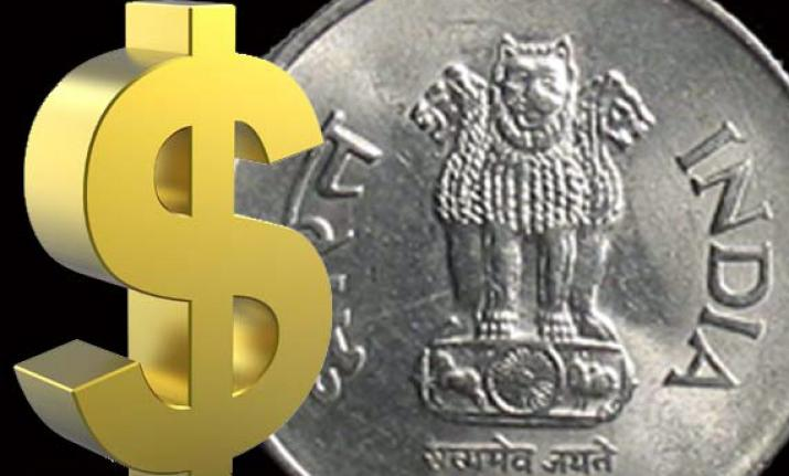Rupee plunges 79 paise to record low of 69.62 against US