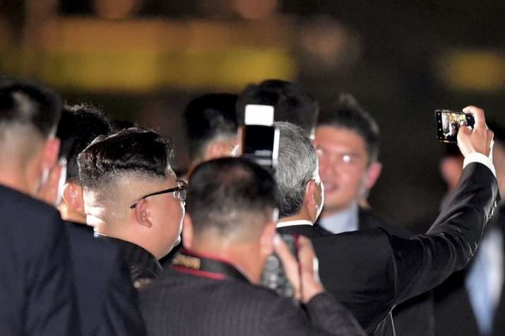 North Korean leader Kim Jong un, seen from back, takes a