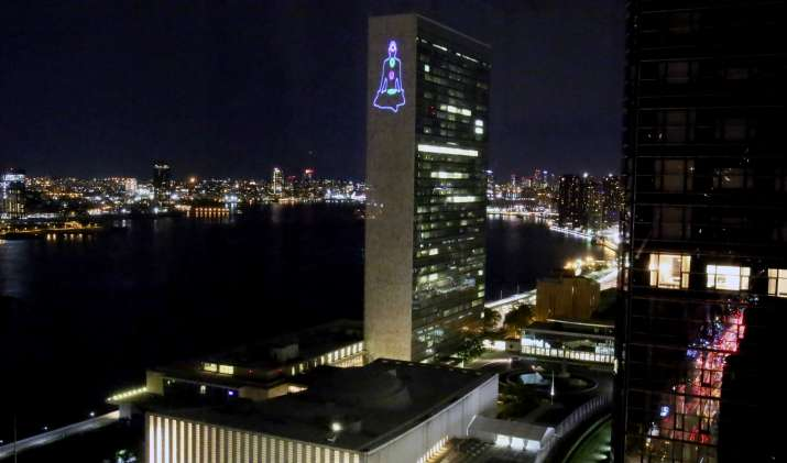 India Tv - A display of yoga postures through laser light beams on UN Secretariat wall to commemorate International Day of Yoga 2018, in New York, US.