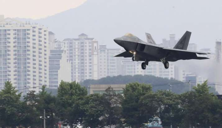 India Tv - A US F-22 Raptor stealth fighter jet lands as South Korea and the United States conduct the Max Thunder joint military exercise at an air base in Gwangju, South Korea, on May 16.
