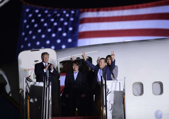 India Tv - US President Donald Trump, from left, greets Tony Kim, Kim Hak Song, seen in the shadow, and Kim Dong Chul, three Americans detained in North Korea for more than a year, as they arrive at Andrews Air Force Base in Md.