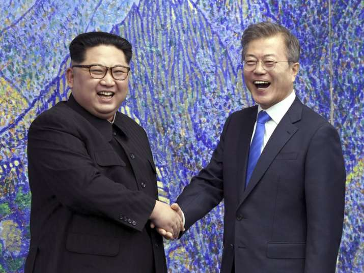 India Tv - North Korean leader Kim Jong Un, left, poses with South Korean President Moon Jae-in on April 27