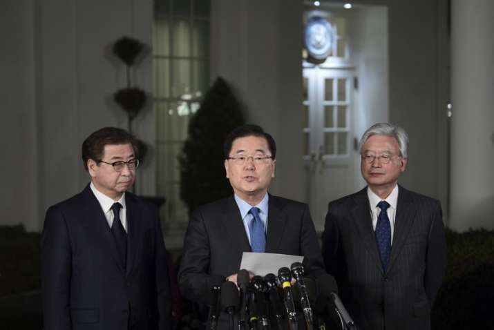 India Tv - South Korean national security director Chung Eui-yong, center, speaks to reporters at the White House.