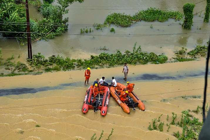 India Tv - An aerial view shows a rescue team operating in the flood-affected Kailashahar town in Unakoti district of Tripura on Friday.