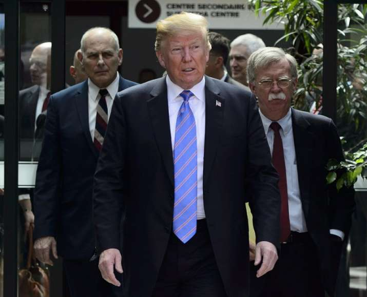 India Tv - US President Donald Trump leaves the G7 Leaders Summit in La Malbaie on Saturday, June 9, 2018., with White House Chief of Staff John Kelly, left, and National Security Adviser John Bolton.