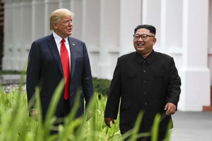 India Tv - US President Donald Trump and North Korea leader Kim Jong Un walk from their lunch at the Capella resort on Sentosa Island on Tuesday