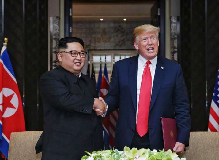 Kim Jong Un and Donald Trump moments after inking the